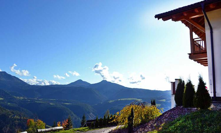 Panoramic view tot he Dolomites from the mountain farm Samer
